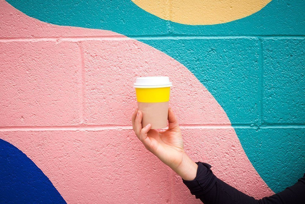 coffee cup against painted wall