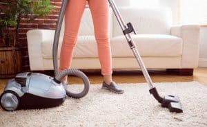 woman vacuuming her house fast