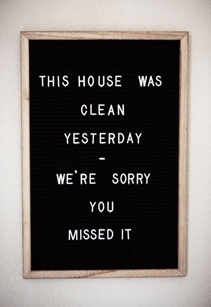 felt board with a quote about missing a clean house