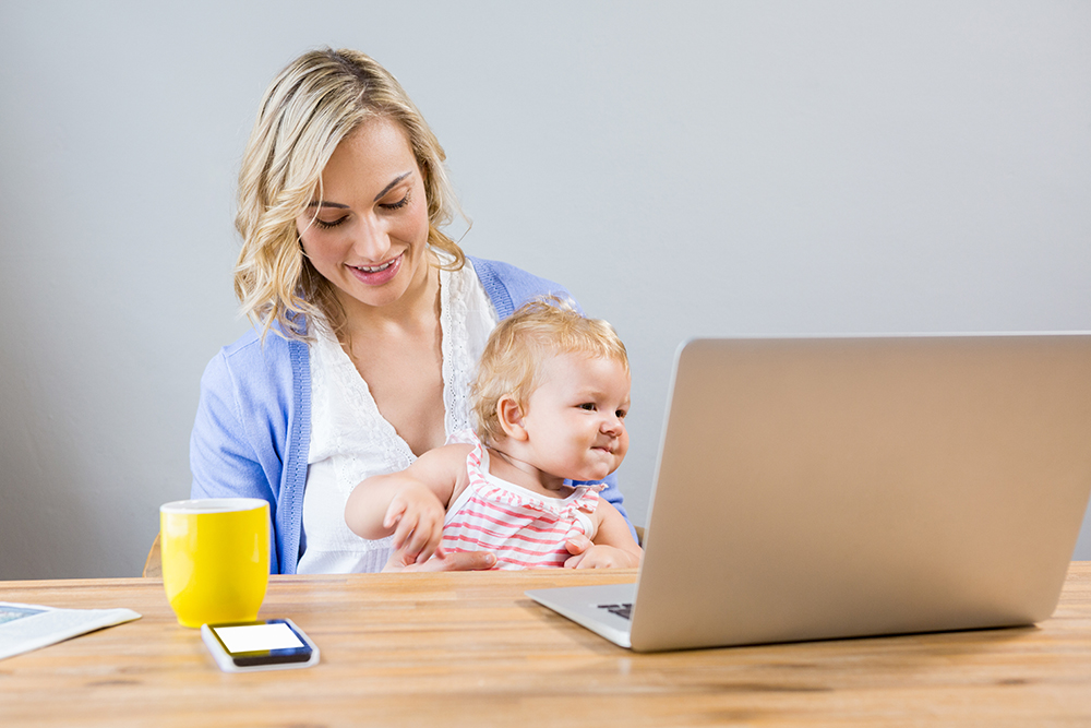 mom working with baby on her lap