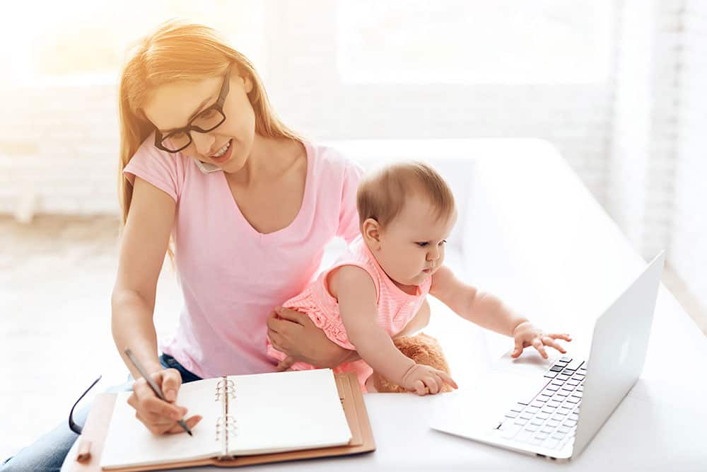 mom working at home with a baby