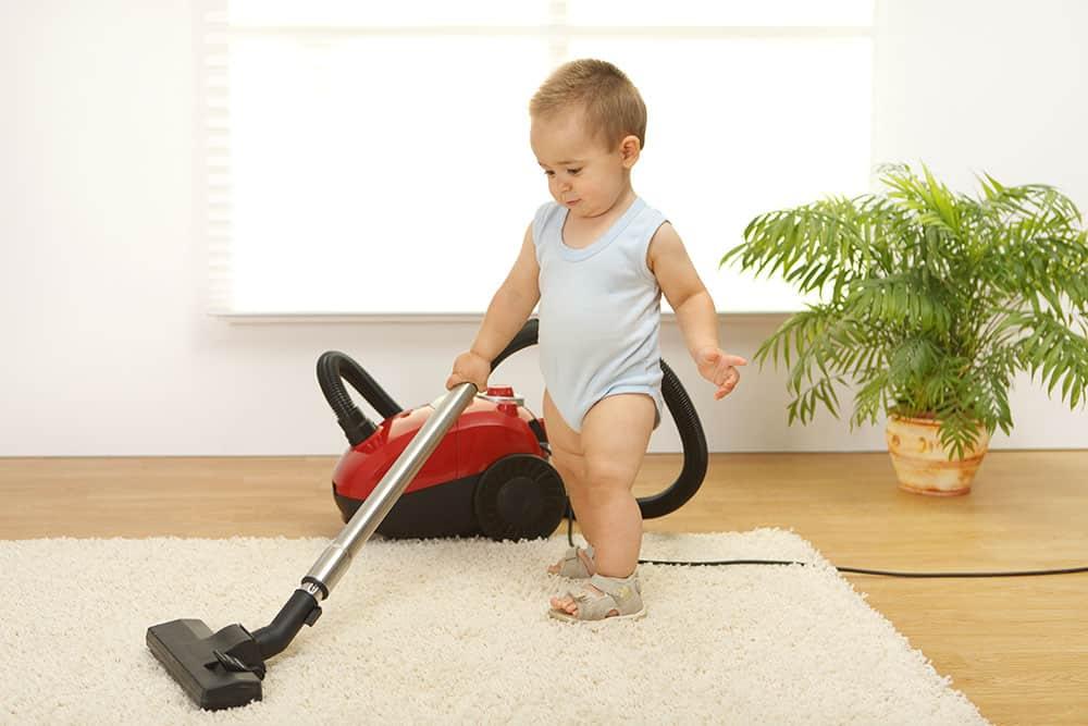 little kid cleaning floors