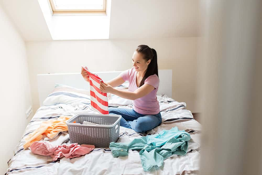 woman going through things to declutter