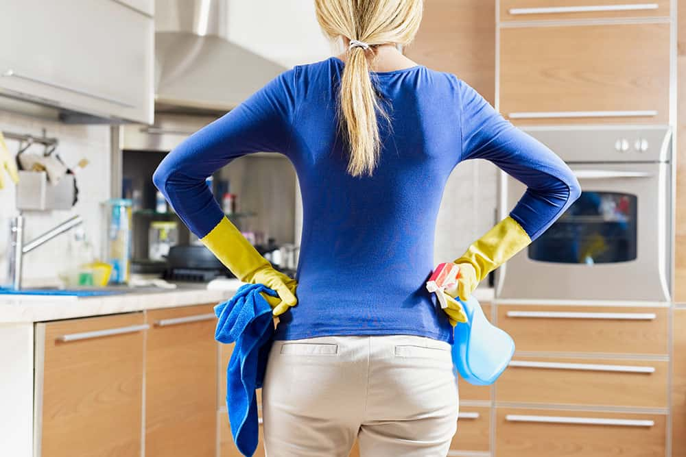 mom cleaning using her cleaning schedule for working moms